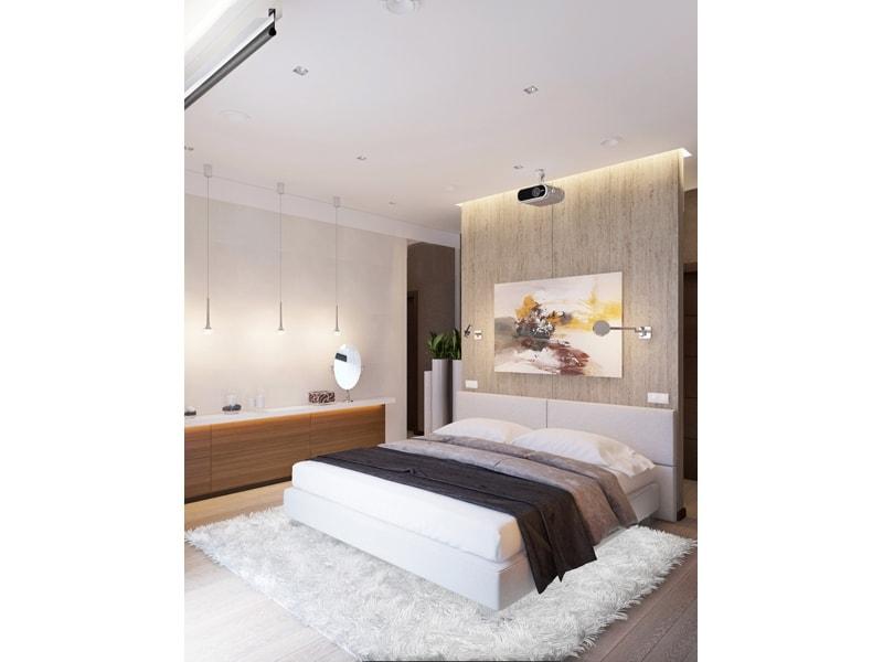 Светлая спальня с деревянной стенкой