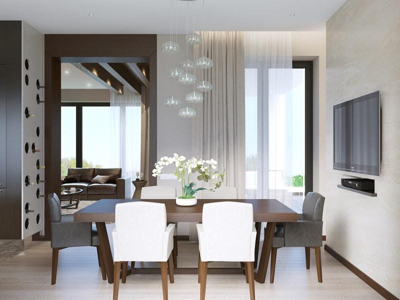 Интерьер столовой комнаты с просторным столом