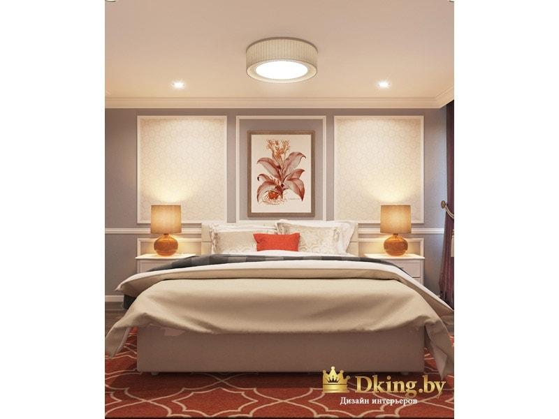 спальня: вид на большую двухспальную кровать. Изголовье украшено молдингами и картиной, перекликающейся по цвету с ковром