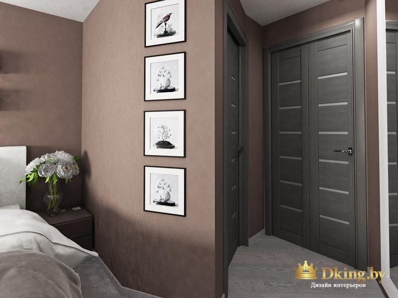 темные двери и серый пол в спальне. декор стены фотографиями в темных рамках с белыми паспарту.