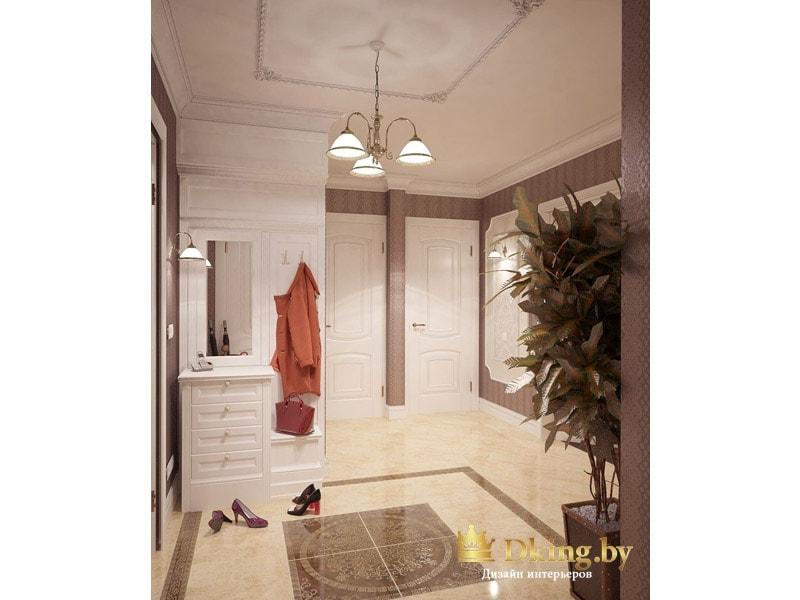 прихожая: декор на потолке в области расположения классического светильника, на полу панно из глянцевой плитки в виде ковра