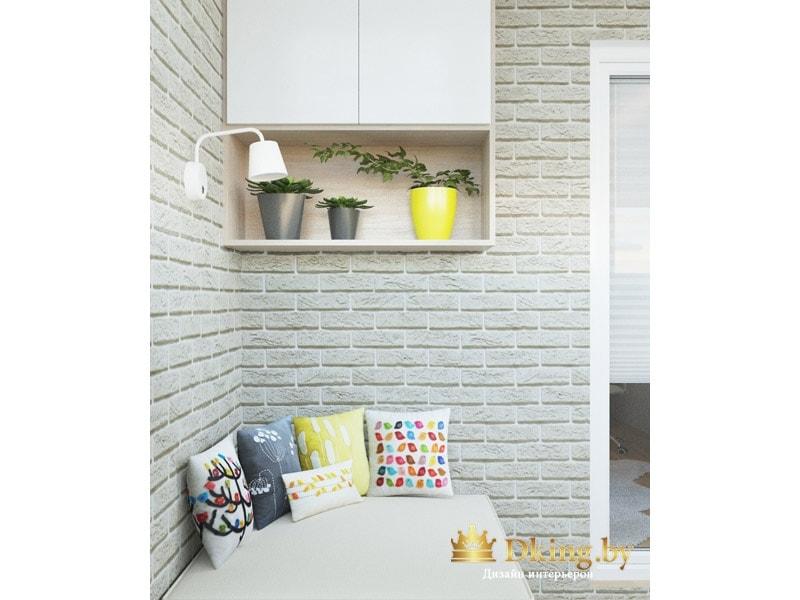 балкон как место для отдыха: белый диван-кушетка с цветными подушками, шкафчик для хранения. стены декорированы искусственным кирпичом.