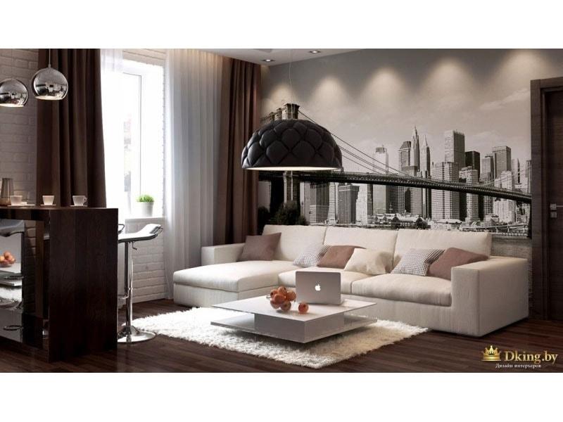 гостиная: шоколадные шторы, темный пол, светлый ковер, белый журнальный столик, светло-бежевый угловой диван. акцентная стена с изображением города и дизайнерский светильник