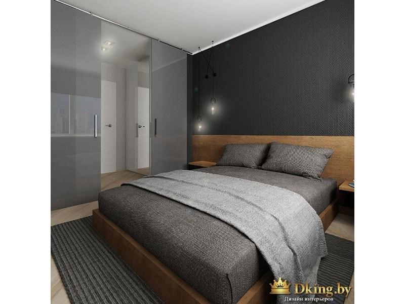 спальня: деревянная кровать со сплошным низким изголовьем. за изголовьем - темная серая стена. текстиль серый льняной. пол под дерево, потолок белый. ковер серый в тон покрывала