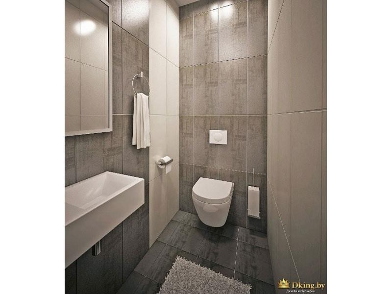 санузел: подвесной унитаз. стены и пол вылоежны серой плиткой. одна стена белая. умывальник подвесной белый прямоугольный.