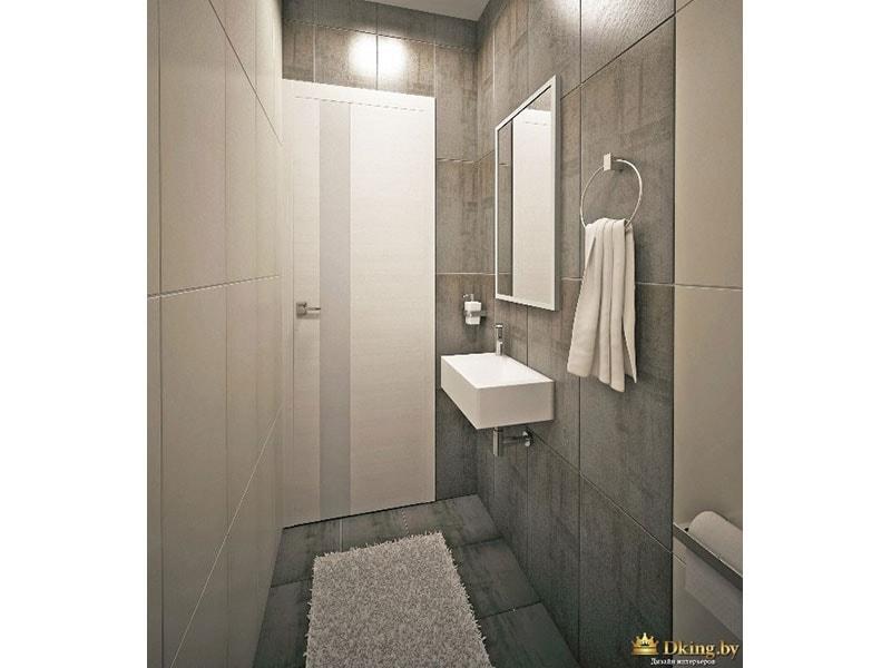 санузел: белый подвесной умывальник прямоугольной формы. прямоугольная серая и белая плитка, уложенная вертикально