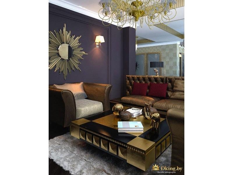 темно-фиолетовая стена, зеркало в раме в виде солнца, шикарные кресла с обивкой белого и бронзового цветов, раритетный журнальный столик