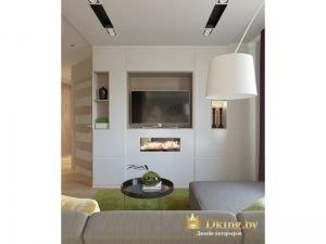 интересное решение для оформления стены с телевизором в гостиной: сплошная белая система для хранения без ручек. под теелвизор и декор сделаны ниши. под телевизором в белую конструкцию вмонтирован искусственный камин