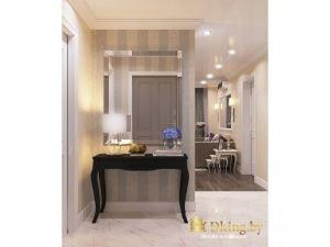 белый глянцевый пол в прихожей и темный паркет в квартире. На стене расположено зеркало с подсветкой и классический туалетный столик цвет венге