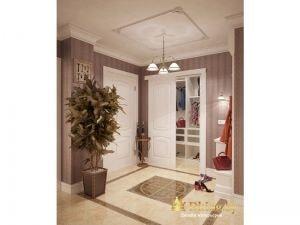 панно из плитки на полу в прихожей сочетается с геометрическим панно на потолке.