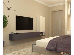 Плазменный телевизор, расположенный перед кроватью