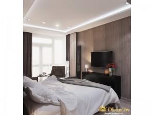 Двуспальная кровать напротив телевизора