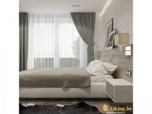 Большая кровать с серым покрывалом