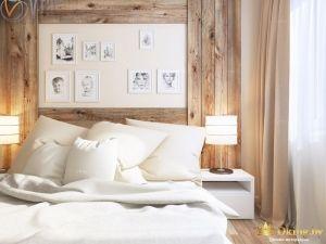 Деревянная спальня с гравюрами на стене