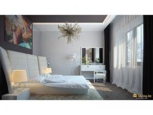 спальная зона: низкая кровать, белый туалетный столик, картина с абстрактным изображением