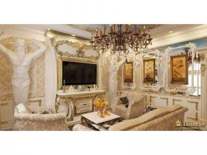 колонна в виде атланта, поддерживающего свод потолка, телевизор расположен над классической консолью, стена за телевизором украшена позолоченными узорами и вензелями. На стене - картины в пафосных рамах и витиеватых молдингах