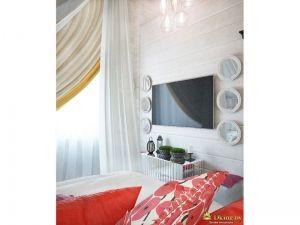 телевизор в спальне. в качестве декора - белые круглые маленькие зеркала в белых деревянных рамах, расположенные симметрично по три в ряд справа и слева