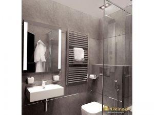 ванная с серой плиткой, подвесным белым умывальником и унитазом, душевым уголком и зеркалом с подсветкой