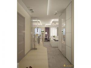 вид из прихожей на гостиную: большой встроенный шкаф-купе. пол выложен плиткой и ламинатом. граница формы зигзаг