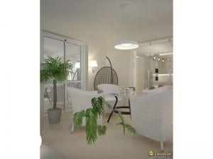 зона отдыха: белые кресла, круглый столик, подвесное круглое сетчатое кресло.