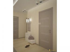 светлая дверь, молочные стены, светло-бежевый пол, белый пуф и комод под зеркалом в прихожей