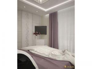 телевизор в углу спальни на кронштейне