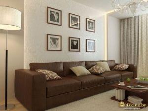 Коричневый кожаный диван с картинами