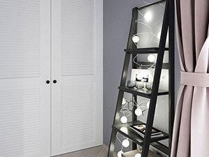 белый шкаф-купе с жалюзийными дверями в интерьере детской комнаты