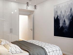 белый встроенный распашной шкаф в интерьере маленькой спальни