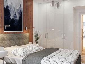 белый распашной глянцевый шкаф из икея в интерьере спальни